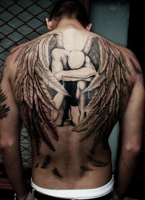 sad-angel-with-large-wings-3d-tattoo-on-back